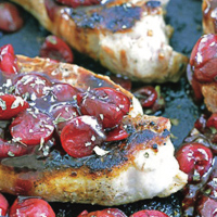 Boneless Pork Chops Smothered in Cherry Sauce
