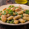Seared Gnocchi with English Peas, Pancetta & Parmigiano-Reggiano